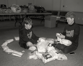 Our volunteer Heather and her son Jarred help sort and package new socks and underware for distribution.